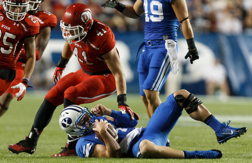 Trent Nelson  |  The Salt Lake Tribune Utah Utes linebacker Jared Norris (41) chases down Brigham Young Cougars quarterback Taysom Hill (4) in the third quarter as the BYU Cougars host the Utah Utes, college football Saturday, September 21, 2013 at LaVell Edwards Stadium in Provo.