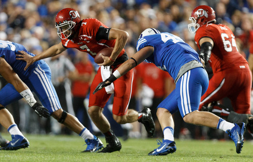 Trent Nelson  |  The Salt Lake Tribune Brigham Young Cougars defensive lineman Remington Peck (44) sacks Utah Utes quarterback Travis Wilson (7) in the first quarter as the BYU Cougars host the Utah Utes, college football Saturday, September 21, 2013 at LaVell Edwards Stadium in Provo.