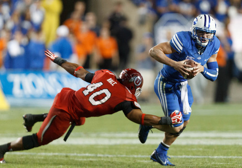 Trent Nelson  |  The Salt Lake Tribune Brigham Young Cougars quarterback Taysom Hill (4) scrambles with Utah Utes linebacker Jacoby Hale (40) in pursuit in the fourth quarter as the BYU Cougars host the Utah Utes, college football Saturday, September 21, 2013 at LaVell Edwards Stadium in Provo.