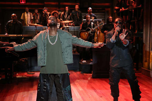 """This publicity image released by NBC shows Kanye West, left, performing during a taping of """"Late Night with Jimmy Fallon,"""" on Monday, Sept. 9, 2013 in New York. (AP Photo/NBC, Lloyd Bishop)"""