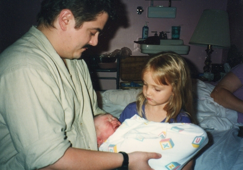 Kya Rose's son, Ben Fouts, meets his father Doug Fouts and sister Faerin at a birth center in Dearborn, Mich. Midwife Valerie El Halta delivered Ben on Aug. 1, 1996. Courtesy photo