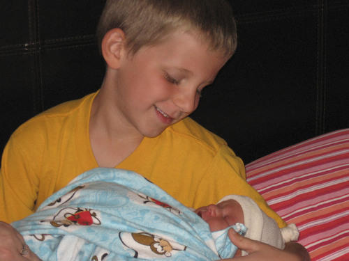   Courtesy Liz Knight Xander Knight, holds his brother Grayson for the first time.