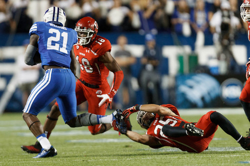 Trent Nelson  |  The Salt Lake Tribune Utah Utes defensive back Eric Rowe (18) and  defensive back Mike Honeycutt (25) close in on Brigham Young Cougars running back Jamaal Williams (21) in the second quarter as the BYU Cougars host the Utah Utes, college football Saturday, September 21, 2013 at LaVell Edwards Stadium in Provo.