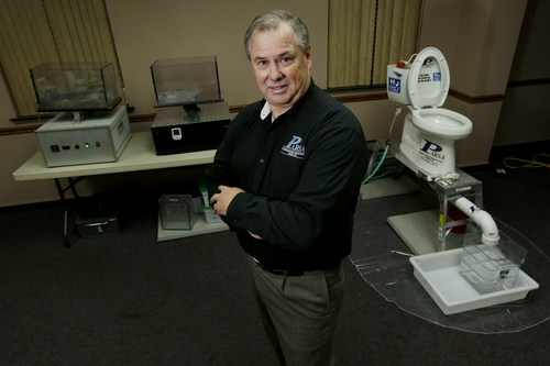 In this photograph taken, Friday, Sept. 20, 2013, in Middlesex, N.J., Rob Villee, executive director of the Plainfield Area Regional Sewer Authority in New Jersey, poses for The Associated Press with his test equipment in his office. Increasingly popular bathroom wipes, thick, premoistened towelettes that are advertised as flushable, are creating clogs and backups in sewer systems around the nation. The problem has gotten so bad in this upstate New York town that frustrated sewer officials traced the wipes back to specific neighborhoods, and even knocked on doors to break the embarrassing news to residents that they are the source of a costly, unmentionable mess. An industry trade group this month revised its guidelines on which wipes can be flushed, and has come out with a universal stick-figure, do-not-flush symbol to put on packaging. (AP Photo/Julio Cortez)