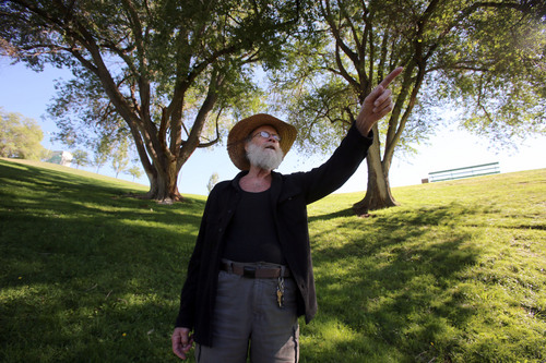 "Francisco Kjolseth  |  The Salt Lake Tribune Robert ""Tree Bob"" Brossard, 68, who grew up in the Avenues tours Lindsey Gardens park and points out the different types of trees that have grown up with him. A tree trimmer by trade, Brossard lived right by the park from 1946 to 1967 and has seen many changes to the area that used to be his backyard playground."