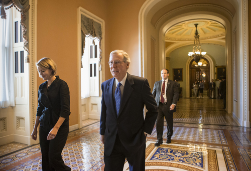 Senate Minority Leader Mitch McConnell of Ky. returns to his office on Capitol Hill in Washington, Tuesday, Sept. 24, 2013, after speaking on the floor of the Senate. In a break with Sen. Ted Cruz, R-Texas, and tea party-aligned Senate conservatives, McConnell announced Monday he will not vote to block legislation aimed at preventing a partial government shutdown.  (AP Photo/J. Scott Applewhite)