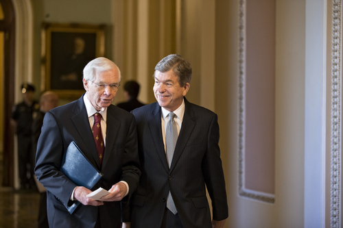 Sen. Thad Cochran, R-Miss., left, and Sen. Roy Blunt, R-Mo. walk to their party caucuses on Capitol Hill in Washington, Tuesday, Sept. 24, 2013, as the Senate struggles with a stopgap spending bill that would prevent a partial government shutdown when the budget year ends next week. Tea party-leaning members of the House GOP caucus successfully attached language to that bill last week that would strip funding for President Barack Obama's health care program. (AP Photo/J. Scott Applewhite)