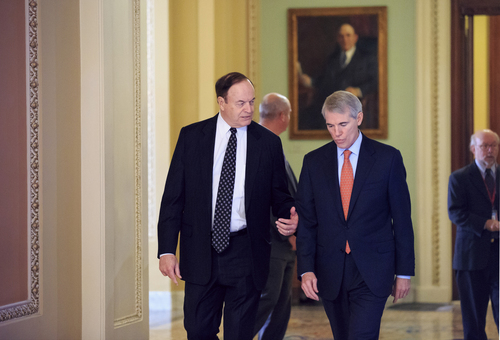 Sen. Richard Shelby, R-Ala., left, and Sen. Rob Portman, R-Ohio, walk to their party caucuses on Capitol Hill in Washington, Tuesday, Sept. 24, 2013, as the Senate struggles with a stopgap spending bill that would prevent a partial government shutdown when the budget year ends next week. Tea party-leaning members of the House GOP caucus successfully attached language to that bill last week that would strip funding for President Barack Obama's health care program. (AP Photo/J. Scott Applewhite)