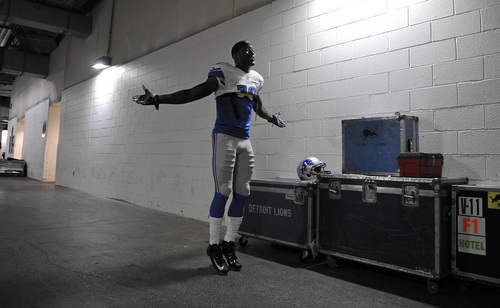 Detroit Lions wide receiver Nate Burleson works out to music in the tunnel of FedEx Field before a NFL football game against the Washington Redskins in Landover, Md., Sunday Sept. 22, 2013. (AP Photo/Richard Lipski)
