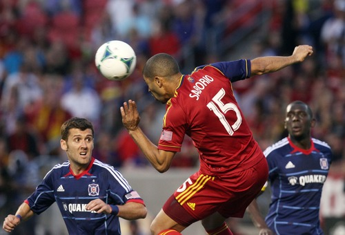 Kim Raff  |  The Salt Lake Tribune (middle) Real Salt Lake forward Alvaro Saborio (15) heads the ball past (left) Chicago Fire defender Gonzalo Segares (13) during the second  half of the match at Rio Tinto Stadium in Sandy on May 25, 2013. The match ended in a 1-1 tie.