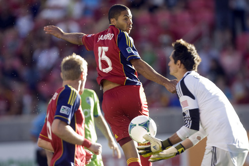 Kim Raff  |  The Salt Lake Tribune (middle) Real Salt Lake forward Alvaro Saborio (15) heads the ball and (right) Seattle Sounders FC goalkeeper Michael Gspurning (1) makes a save during the first half at Rio Tinto Stadium in Sandy on June 22, 2013.