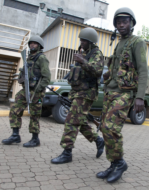 Kenya Defence Force soldiers move towards the Westgate Mall in Nairobi, Kenya Tuesday, Sept. 24, 2013.  Kenyan security forces battled al-Qaida-linked terrorists in an upscale mall for a fourth day. Another explosion and more gunfire could be heard coming from the mall in the early hours of Tuesday morning.(AP Photo/Sayyid Azim)