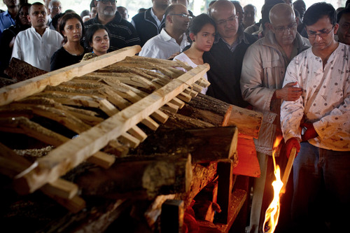 Ramesh Vaya, right, lights the funeral pyre of his wife Malti, who was shot dead in the attack on the Westgate Mall, at her funeral at the Hindu Crematorium in Nairobi, Kenya Tuesday, Sept. 24, 2013. Ramesh and his brother both lost their wives in the attack. Kenyan President Uhuru Kenyatta says security forces have finally defeated a small group of terrorists after four days of fighting at the Nairobi mall. (AP Photo/Kate Holt)