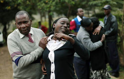Relatives of Johnny Mutinda Musango, 48, weep after identifying his body at the city morgue  in Nairobi, Kenya Tuesday Sept. 24 2013. Musango was one of the victims of the Westgate Mall hostage siege. Kenyan security forces were still combing the Mall on the fourth day of the siege by al-Qaida-linked terrorists. (AP Photo/ Jerome Delay)