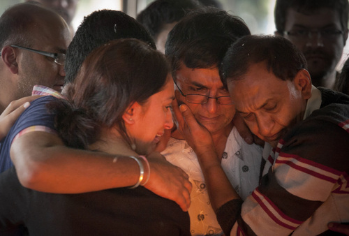 Ramesh Vaya, center, is comforted by family members after lighting the funeral pyre for his wife Malti, who was shot dead in the attack on the Westgate Mall, at her funeral at the Hindu Crematorium in Nairobi, Kenya Tuesday, Sept. 24, 2013. Ramesh and his brother both lost their wives in the attack. Kenyan President Uhuru Kenyatta says security forces have finally defeated a small group of terrorists after four days of fighting at the Nairobi mall. (AP Photo/Kate Holt)
