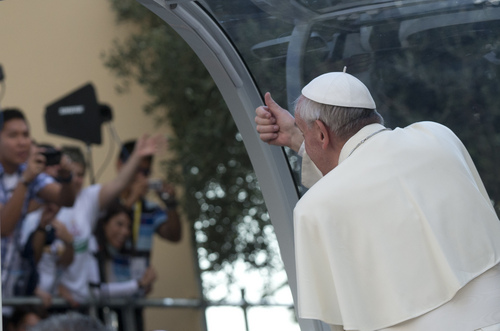 Pope Francis gives the thumb-up sign as he leaves after a meeting with youths in downtown Cagliari, Italy, Sunday, Sept. 22, 2013. Francis denounced what he called big business's idolatry of money over man as he traveled Sunday to one of Italy's poorest regions to offer hope to the unemployed and entrepreneurs struggling to hang on. (AP Photo/Alessandra Tarantino)