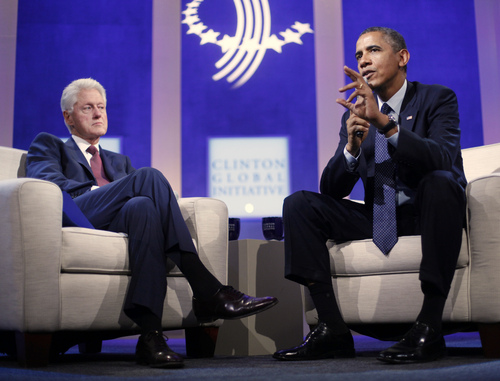 President Barack Obama, right, with former President Bill Clinton, left, speaks at the Clinton Global Initiative in New York, Tuesday, Sept. 24, 2013. Obama is directly engaging in the promotional campaign for Affordable Care Act. He and Clinton talked health care during the session sponsored by Clinton's foundation, and Obama is planning a speech on the law on Thursday.  (AP Photo/Pablo Martinez Monsivais)