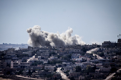 Smoke rises from buildings after an airstrike hit in Habit village, in the Syrian central province of Hama, Wednesday, Sep. 25, 2013. (AP Photo)