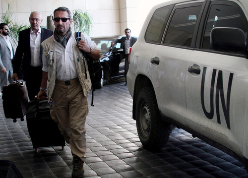 """U.N. experts arrive to the Four Seasons hotel in Damascus, Syria, Wednesday, Sept. 25, 2013. A team of U.N. chemical weapons inspectors returned to Damascus on Wednesday to complete their investigation into what the UN calls """"pending credible allegations"""" of chemical weapons use in Syria's civil war. The six-member team is led by Swedish expert Ake Sellstrom. (AP Photo)"""