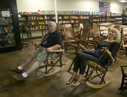 Rick Egan  | The Salt Lake Tribune   Ray Banks, West Jordan, and Heidi Johnson, Layton, test out the rocking chairs at Apple Creek Bulk Foods, 875 N. Main, Willard, on Highway 89, Wednesday, September 4, 2013.