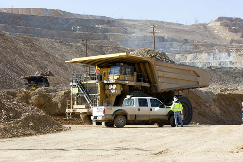 Al Hartmann  |  The Salt Lake Tribune Heavy machinery removes debris at Kennecott on Thursday, April 25, 2013. The landslide will hinder copper production this year, which could mean lost jobs and scant supplies for customers.