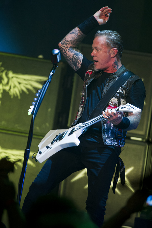 James Hetfield from Metallica performs at a private concert for SiriusXM listeners at the Apollo Theater on Saturday, Sept. 21, 2013 in New York. (Photo by Charles Sykes/Invision/AP)