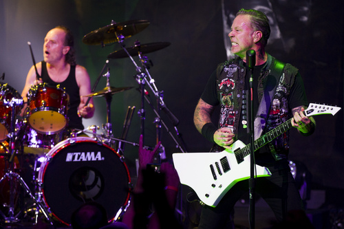 Lars Ulrich, left, and James Hetfield from Metallica perform at a private concert for SiriusXM listeners at the Apollo Theater on Saturday, Sept. 21, 2013 in New York. (Photo by Charles Sykes/Invision/AP)