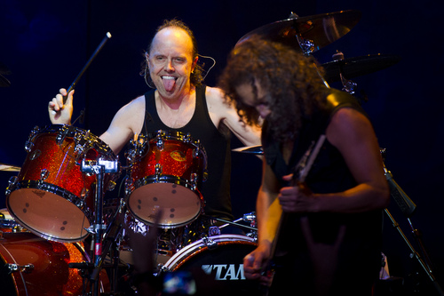 Lars Ulrich, left, and Kirk Hammett from Metallica perform at a private concert for SiriusXM listeners at the Apollo Theater on Saturday, Sept. 21, 2013 in New York. (Photo by Charles Sykes/Invision/AP)