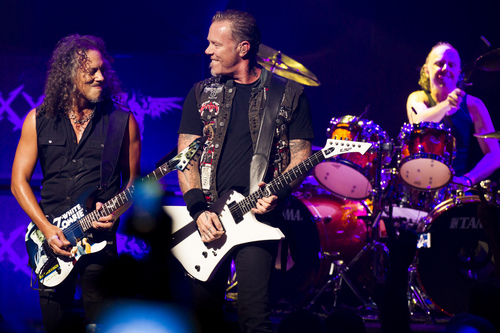 Metallica members, from left, Kirk Hammett, James Hetfield and Lars Ulrich perform at a private concert for SiriusXM listeners at the Apollo Theater on Saturday, Sept. 21, 2013 in New York. (Photo by Charles Sykes/Invision/AP)