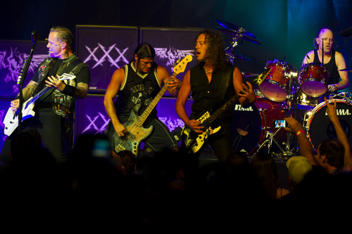 Metallica members, from left, James Hetfield, Robert Trujillo, Kirk Hammett and Lars Ulrich perform at a private concert for SiriusXM listeners at the Apollo Theater on Saturday, Sept. 21, 2013 in New York. (Photo by Charles Sykes/Invision/AP)