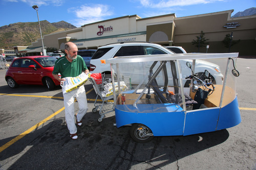 Francisco Kjolseth     The Salt Lake Tribune Andy Schoenberg, a retired bioengineering professor from the University of Utah and a former NASA engineer, loads up on supplies at his nearby neighborhood store near Millcreek Canyon recently. Schoenberg, who has been developing solar-powered vehicles for about 15 years, is trying to bring them to market. His Ecotrikes harness the power of the sun through a solar panel that makes up the roof of the small vehicle that can be licensed as a motorcycle.
