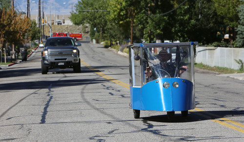 Francisco Kjolseth     The Salt Lake Tribune Traveling fuel free, Andy Schoenberg, a retired bioengineering prof from the University of Utah and a former NASA engineer, drives his solar-powered vehicle the Ecotrike 14 that he's trying to bring to market. His Ecotrikes harness the power of the sun through a solar panel that makes up the roof of the small vehicle giving him an average top speed of 33mph and a range of 50 miles. The vehicle can be licensed in Utah as a motorcycle making it legal to drive on the roads.