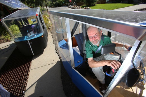 Francisco Kjolseth     The Salt Lake Tribune Andy Schoenberg, a retired bioengineering professor from the University of Utah and a former NASA engineer, sits behind the wheel of his Ecotrike 14. The solar vehicle, along with the 11th version at left, has undergone many upgrades since the first one he created and now he's trying to bring it to market. His Ecotrikes harness the power of the sun through a solar panel that makes up the roof of the small vehicle.
