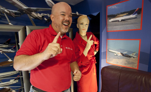 Steve Griffin  |  The Salt Lake Tribune  Longtime Delta Air Lines flight steward, Perry de Vlugt, with a mannequin dressed in vintage Delta Air Lines clothing in his seven-room basement in Salt Lake City, Friday, Sept. 20, 2013. He has turned the entire basement into a museum of old Delta memorabilia, complete with a lavatory from an old plane.