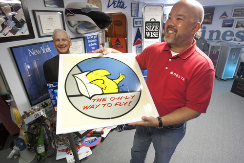 Steve Griffin  |  The Salt Lake Tribune  Longtime Delta Air Lines flight steward, Perry de Vlugt, with a Western Airlines sign in his seven-room basement in Salt Lake City Friday, Sept. 20, 2013. He has turned the entire basement into a museum of old Delta memorabilia, complete with a lavatory from an old plane.