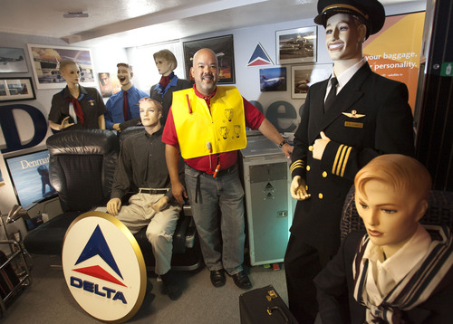 Steve Griffin  |  The Salt Lake Tribune  Longtime Delta Air Lines flight steward, Perry de Vlugt, with mannequins dressed in vintage Delta Air Lines clothing in his seven-room basement in Salt Lake City, Friday, Sept. 20, 2013. He has turned the entire basement into a museum of old Delta memorabilia, complete with a lavatory from an old plane.