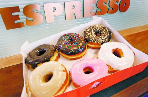 Scott Sommerdorf   | Tribune file art A box of Dunkin' Donuts doughnuts.