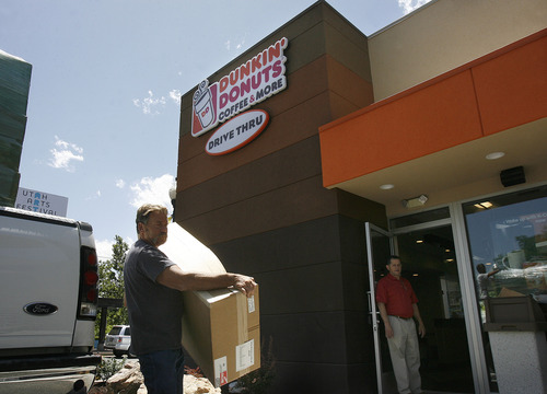 Scott Sommerdorf   |  The Salt Lake Tribune Display tables and furniture being delivered to Dunkin' Donuts on Wednesday, June 19, 2013, which is opening its first Utah store at 217 E. 400 South in Salt Lake City on Tuesday, June 25.