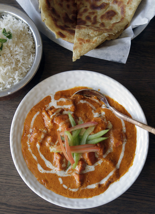 Al Hartmann  |  The Salt Lake Tribune Copper Bowl's Chicken Tikka Masala, served with rice and multi-layered whole wheat bread.