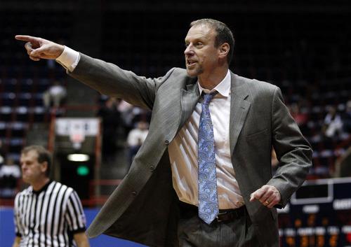 Utah head coach Larry Krystkowiak instructs his team in the second half of an NCAA college basketball game against SMU, Wednesday, Nov. 28, 2012, in Dallas. SMU won 62-55. (AP Photo/Tony Gutierrez)