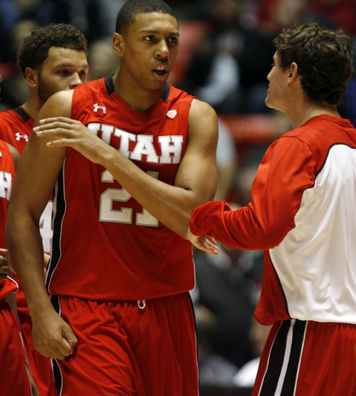 Rick Egan  | The Salt Lake Tribune   Utah Utes forward Jordan Loveridge (21) celebrates after hitting a big three-pointer, in the second half, Saturday, November 24, 2012. The Utes defeated the Wright State Raiders, 66-54, in the Thanksgiving Tournament at the Huntsman Center,