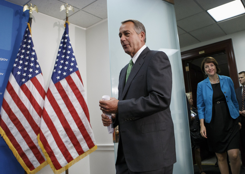 "House Speaker John Boehner Ohio, followed by Rep. Cathy McMorris Rodgers, R-Wash., the Republican Conference chair, arrives to meet with reporters on Capitol Hill in Washington, Thursday, Sept. 26, 2013, after a closed-door strategy session. Pressure is building on fractious Republicans over legislation to prevent a partial government shutdown, as the Democratic-led Senate is expected to strip a tea party-backed plan to defund  the Affordable Care Act, popularly known as ""Obamacare,"" from their bill. (AP Photo/J. Scott Applewhite)"