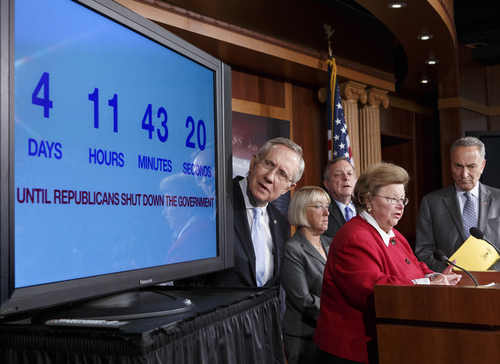 With four days to go before the federal government is due to run out of money, Senate Majority Leader Harry Reid, D-Nev., left, looks at a countdown clock during a news conference on Capitol in Washington, Thursday, Sept. 26, 2013, where Senate Democratic leaders blamed conservative Republicans for holding up a stopgap spending bill to keep the government running. From left are, Reid, Senate Budget Committee Chair Sen. Patty Murray, D-Wash., Senate Majority Whip Richard Durbin of Ill., Senate Appropriations Committee Chair Sen. Barbara Mikulski, D-Md., and Sen. Charles Schumer, D-N.Y., the Democratic Policy Committee chairman.   (AP Photo/J. Scott Applewhite)