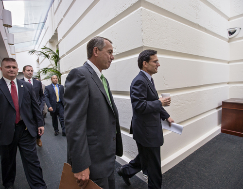 "House Speaker John Boehner of Ohio, center, and House Majority Leader Eric Cantor of Va., right, walk to a Republican caucus on Capitol Hill in Washington, Thursday, Sept. 26, 2013. Boehner said later at a news conference that the GOP-controlled House will not accept a temporary spending bill from the Democratic Senate if it is shorn clean of a tea party plan to ""defund Obamacare.""  (AP Photo/J. Scott Applewhite)"