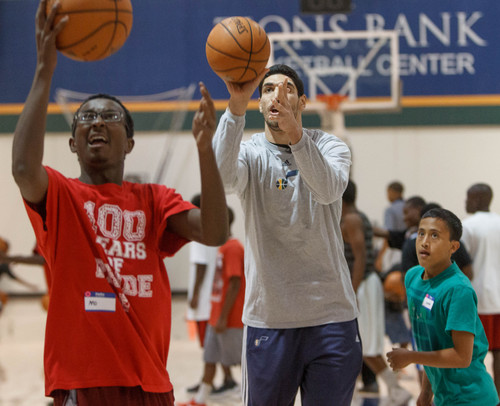 Trent Nelson     The Salt Lake Tribune Utah Jazz center Enes Kanter gets into the drill at a basketball clinic for youth affiliated with the State Refugee Services Office and Because He Loved us First ministry, in Salt Lake City, Thursday, September 26, 2013.
