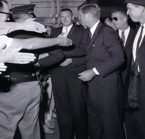 photo courtesy Utah State Historical Society  John F. Kennedy greets people at the Hotel Utah before giving a speech at Temple Square on September 26, 1963.