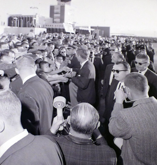 photo courtesy Utah State Historical Society  John F. Kennedy greets a crowd at the airport before giving a speech at Temple Square on September 26, 1963.