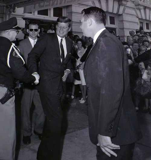 photo courtesy Utah State Historical Society  John F. Kennedy leaves the Hotel Utah before giving a speech at Temple Square on September 26, 1963.
