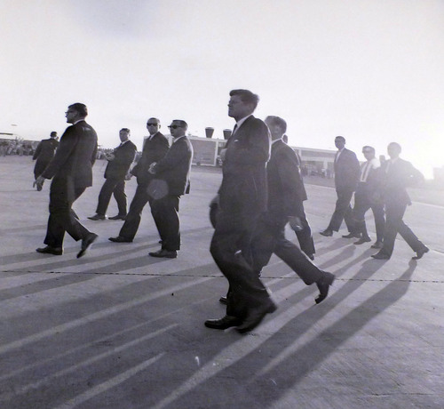 photo courtesy Utah State Historical Society  John F. Kennedy walks across the tarmac at the airport during a visit to Salt Lake City on September 26, 1963.