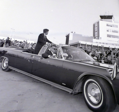 photo courtesy Utah State Historical Society  John F. Kennedy's motorcade leaves the airport during a visit to Salt Lake City on September 26, 1963.